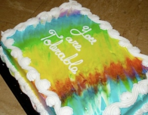 decorated cake, rainbow-colored, bearing the words You Are Tolerable